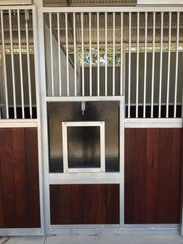 Swing down feed door and bin