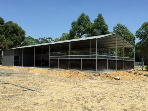 Stables in a line veranda off the front with enclosed area for mare and foal crush to one end , feed and tack room
