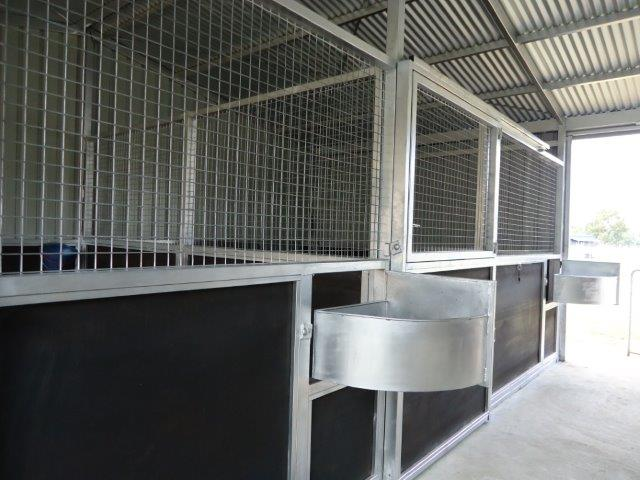 Extra large steel swing out feed bins, able to take hard feed and hay