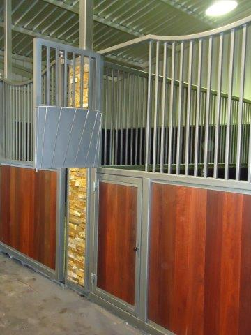 Steel hay rack and feeder doors
