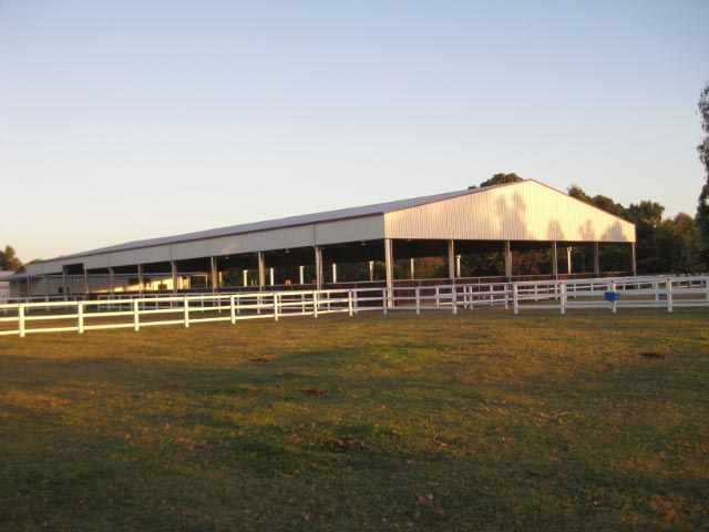 1E-Property Indoor Arena, retic paddocks and white post and rail fencing