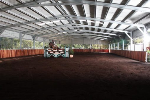 AA Indoor Riding Arena/Wood lined steel enforced on angle sides