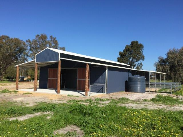Barn Style Stables with bush poles and Jarrah front doors with covered yards