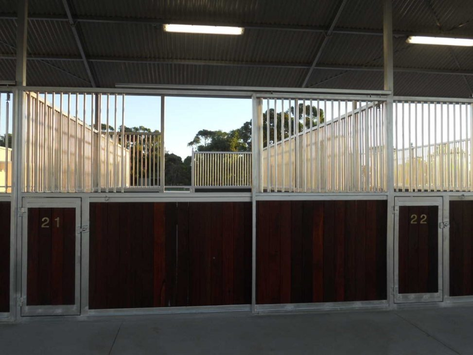 Front of open back stables with sliding entrance doors