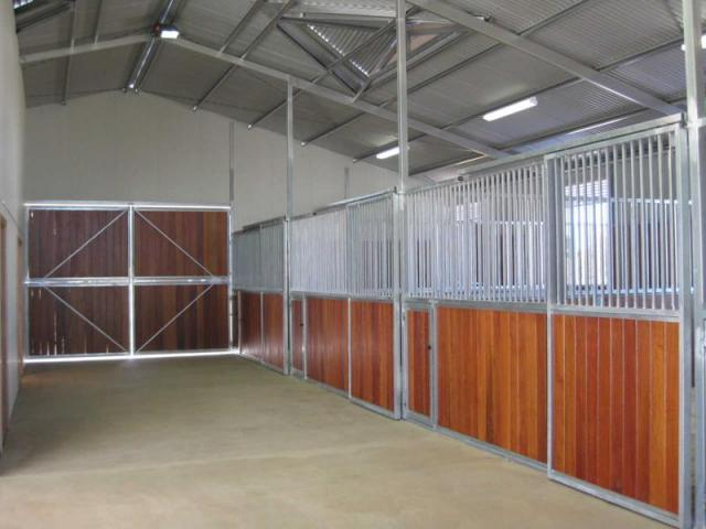 Front double wood doors /stalls lined with wood bars above