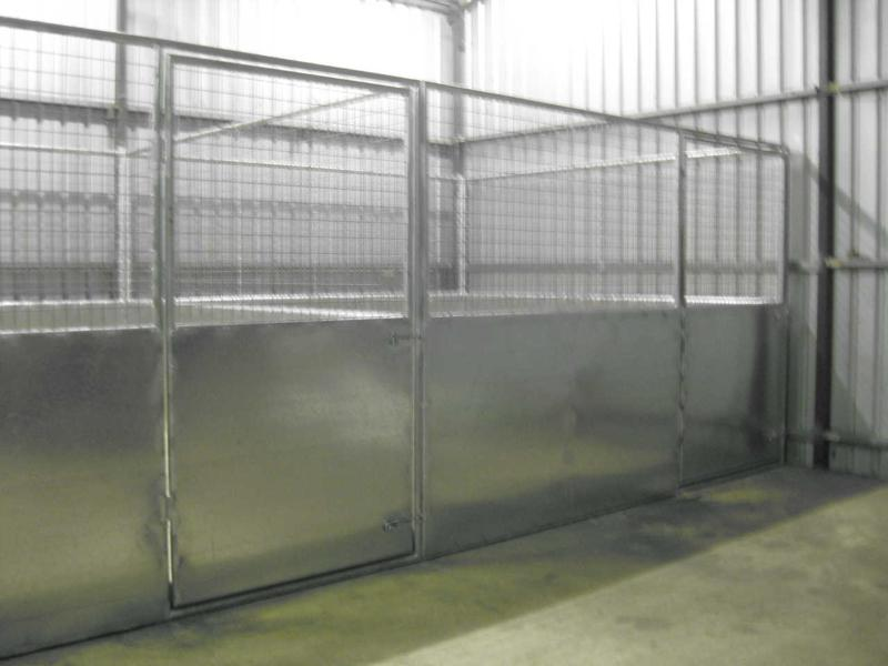 Portable steel stall inside shed