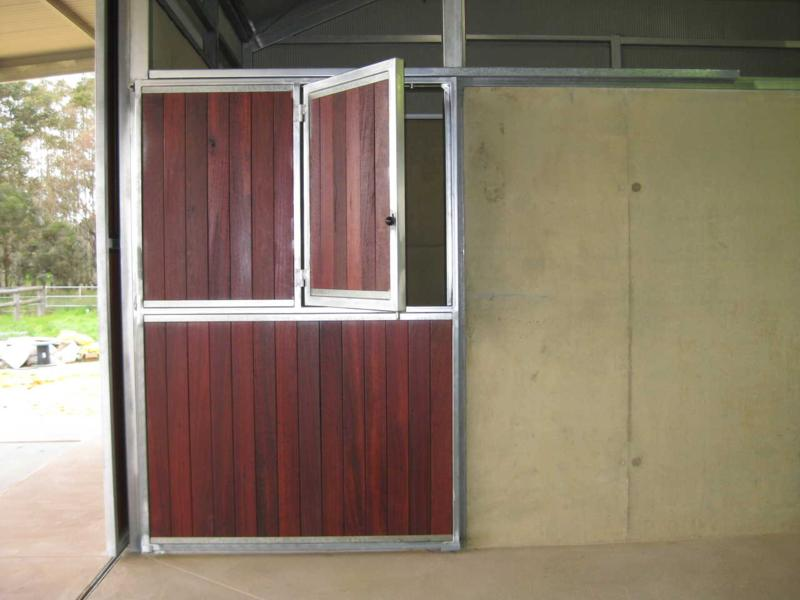 Double jarrah door with top door opening to one side for a teasing