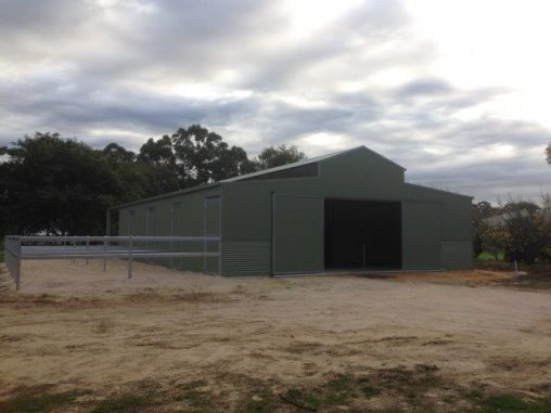 Barn Stables double sliding doors steel yards to side of building
