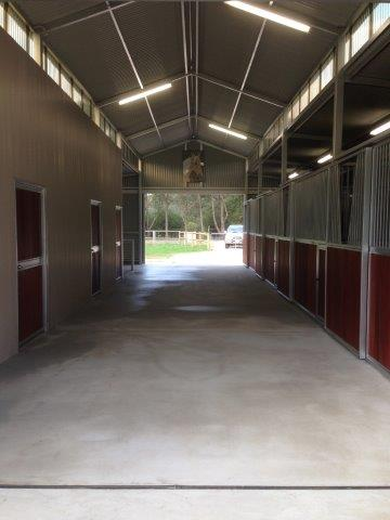 Stalls to one side jarrah fronts V section in bars, wood person doors to feed tack and kitchen toilet