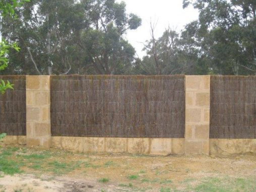 Brush wood and limestone fence