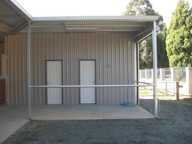 Feed and Tack room off stable lockable doors with under cover wash bay and over head water swing arm