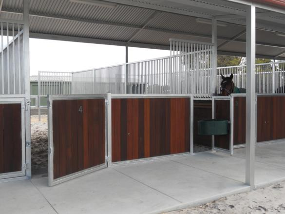 Front of stables steel bars with return open front